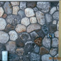 Stones laid out like a puzzle to create a beautiful stone wall