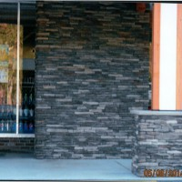 Stone veneer and stone columns at entrance to this commercial property