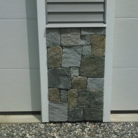Custom stonework on residential garage.