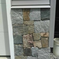Stone facade on residential garage.