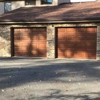 Custom masonry on facade of residential garage.