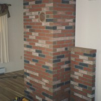 MW Masonry crafted brick chimney and stove surround