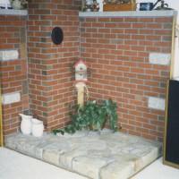 Brick chimney and wood stove surround
