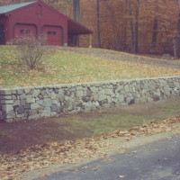 Stacked stone wall adds curb appeal