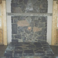Stone fireplace wtih mantel