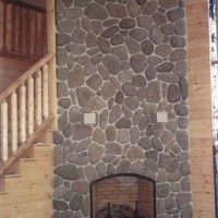 River rock stone fireplace by MW Masonry in Maine