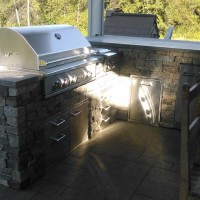 Outdoor kitchen with stone wall