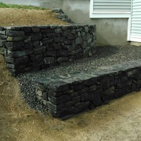 Stone retaining wall on a slope