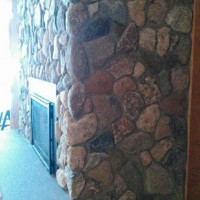 Fieldstone fireplace and chimney