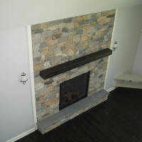 Custom stone masonry fireplace