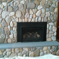 Stone fireplace with hearth built by MW Masonry