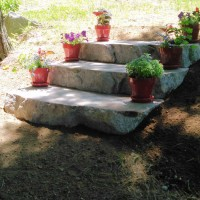 Outdoor stone steps with flower pots